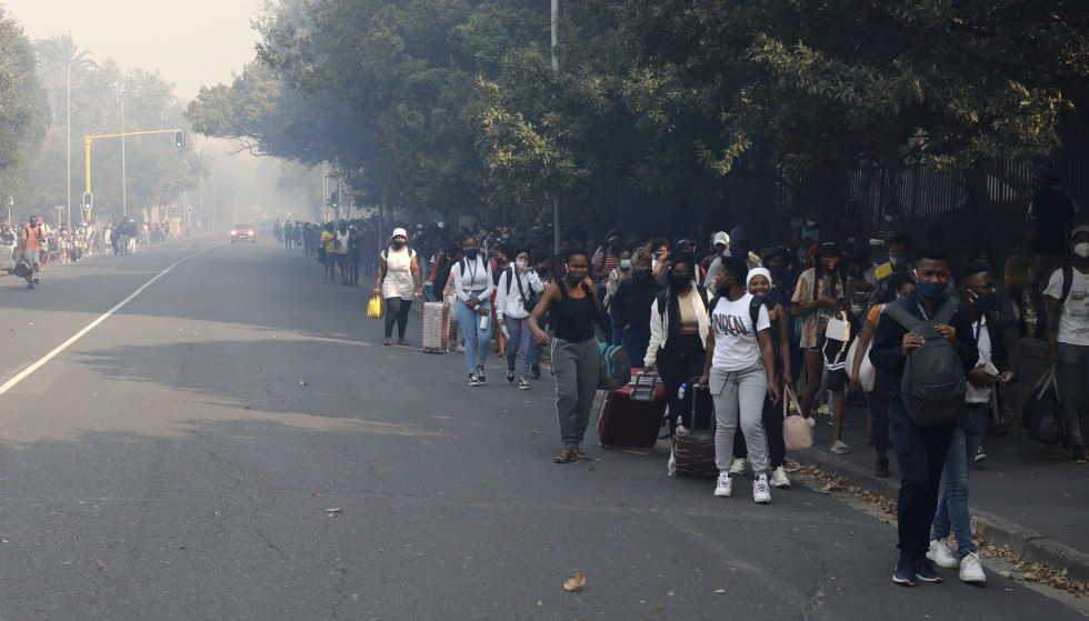 Evacuated: Several hundred students were evacuated from the university due to the fire.  Photo: Nardus Engelbrecht / AP / NTB