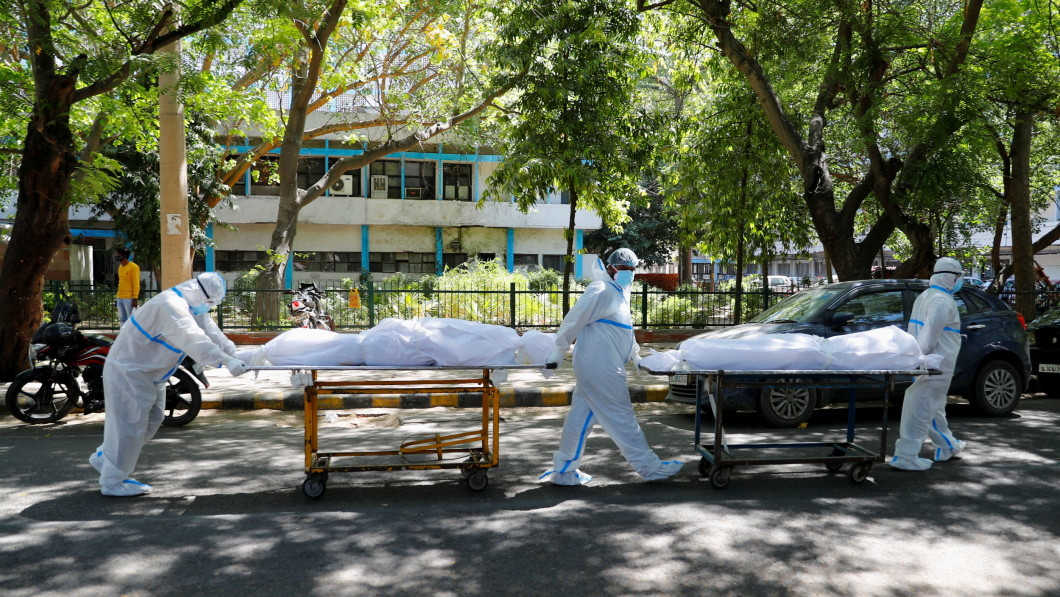 Difficult conditions: Health workers in New Delhi see a number of coronavirus-related deaths in and out of hospitals on a daily basis.