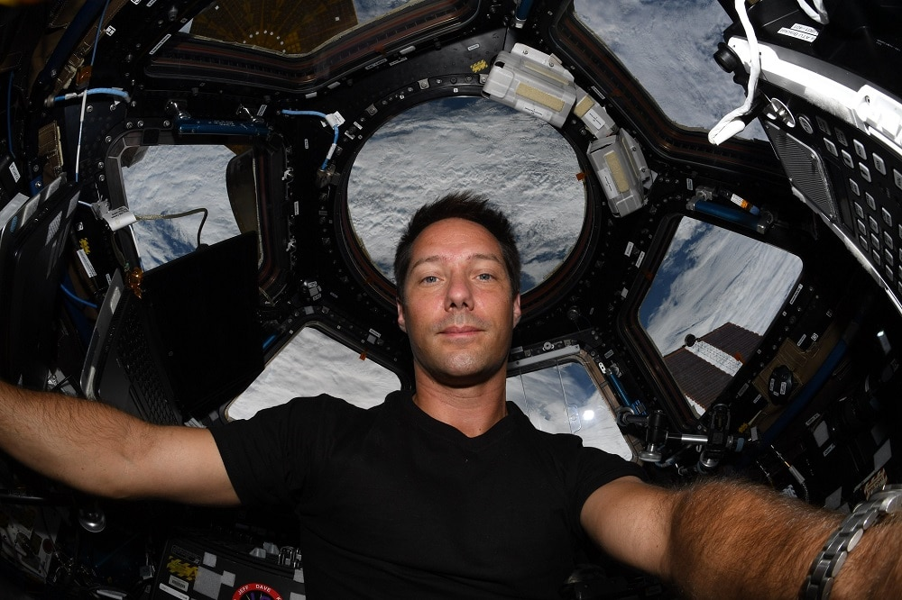 Astronaut shows space station cleaning routine