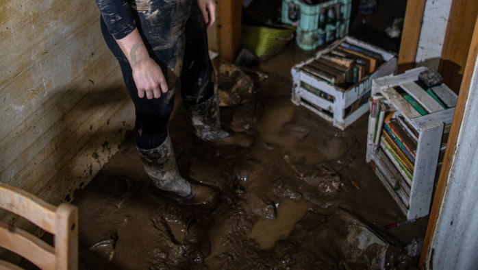 Destroyed: The ground is full of mud and there is nothing left after the flood hit Svenia's apartment.