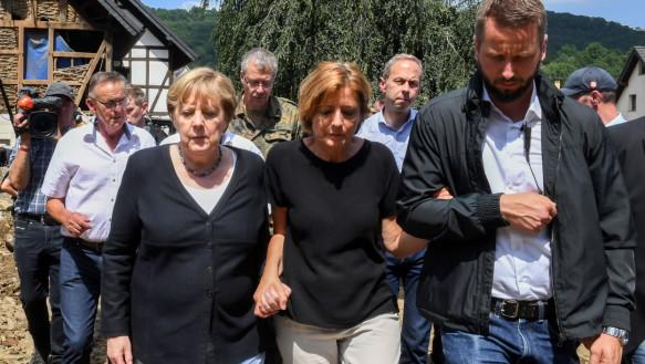 Chancellor Angela Merkel walked alongside the governor of the state of Rhineland-Palatinate, Malu Dreyer, through the flood-ravaged village.